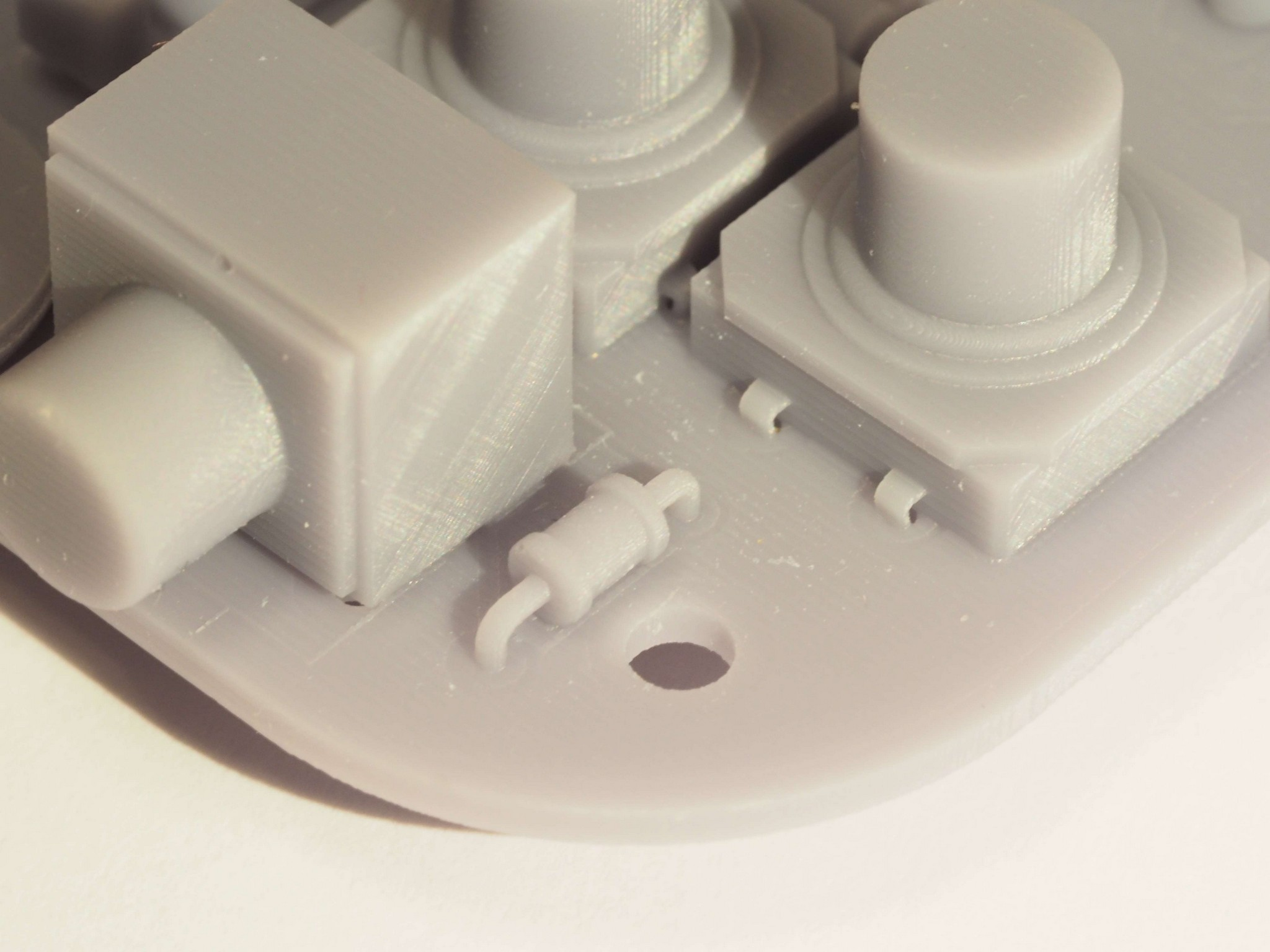 A mounting hole - the model can be used for testing an enclosure. SLA 3D Print of Gamebuino STEP Model